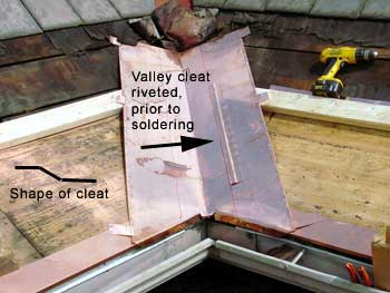 Copper Snow Aprons at slate roof central - valley cleat